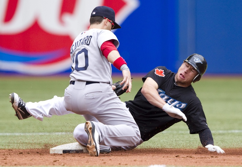 Toronto Blue Jays' Brett Lawrie, right, slides in to steal second under the tag of Boston Red Sox's Marco Scutaro during the second inning in Toronto on Monday. The Blue Jays defeated the Red Sox 1-0. color full length Toronto Toronto Blue Jays colour sports play physical field competitive competition compete athletics athletic athlete action BBA MLB single 2011