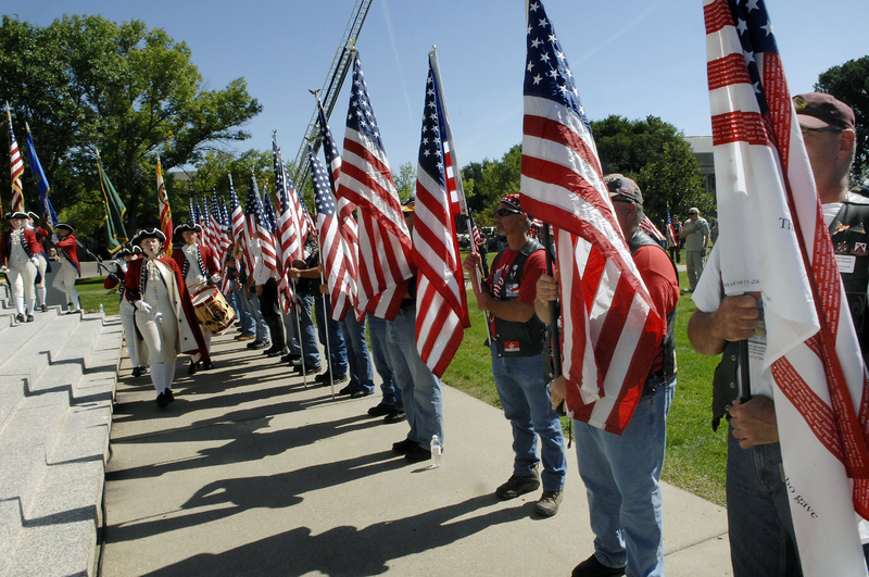 Members of The North Dakota Patriot Guard stand with flags as the Century High School Spirit of '76 marches in to present the colors during the Sept. 11 anniversary observance at the state Capitol building in Bismarck. Nationwide, the efforts of police and military forces allowed such ceremonies to take place without being blighted by terrorist reprisals.