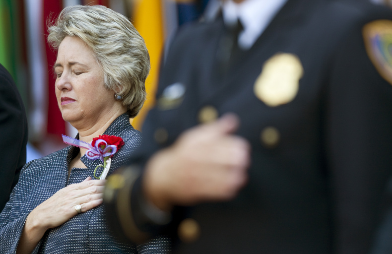 Houston Mayor Annise Parker closes her eyes during a prayer at the city's Sept. 11 Tenth Anniversary commemoration in Hermann Square Friday in Houston.