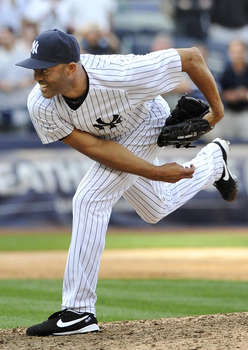 Mariano Rivera pitches in the ninth inning on Monday at Yankee Stadium in New York.