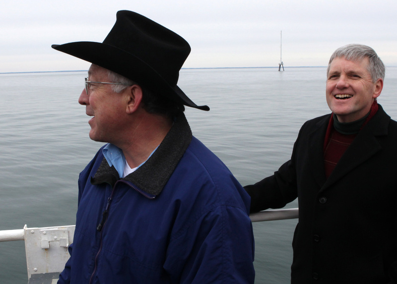 Secretary of the Interior Ken Salazar, left, and Deputy Secretary of the Interior David Hayes take a tour of Nantucket Sound last year to assess the viability of the proposed Cape Wind wind farm. Behind them is a 190-foot meteorological tower, part of the Cape Wind site.