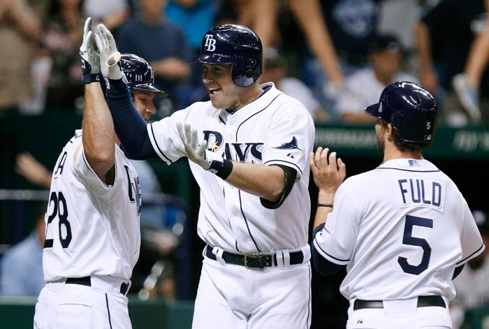Evan Longoria, center, celebrates with teammates after his three-run homer. He later beat the Yankees with a walk-off homer.