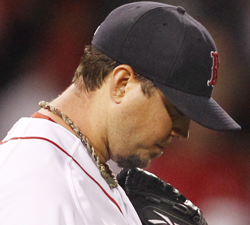 Josh Beckett reacts after giving up two hits to the Orioles in the eighth inning tonight at Fenway Park. Baltimore scored twice in the inning for a 6-4 win.