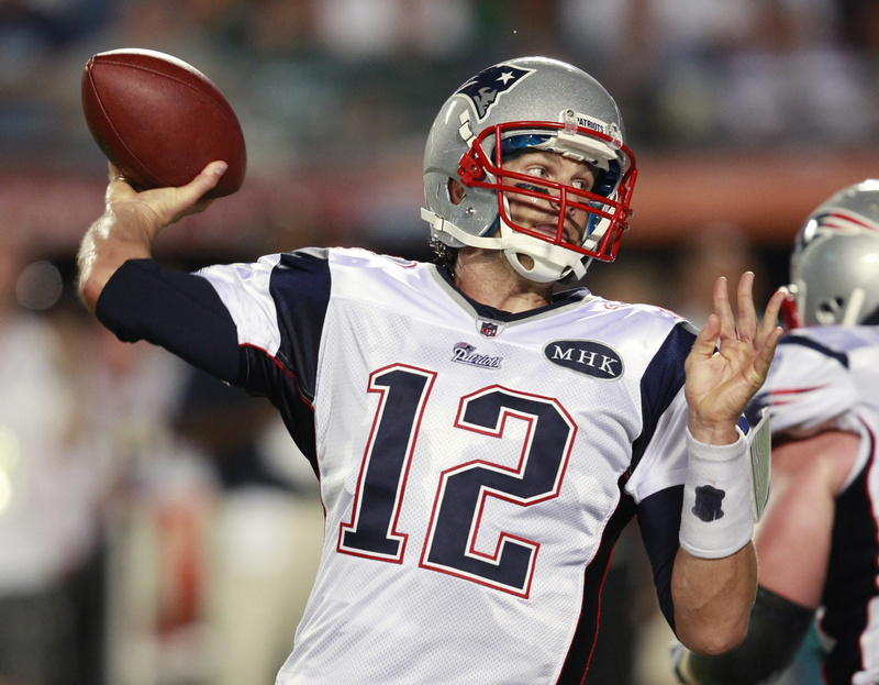 Patriots quarterback Tom Brady throws during the first half tonight's game in Miami. Brady threw for a team-record 517 yards and four TDs as the Patriots won 38-24.