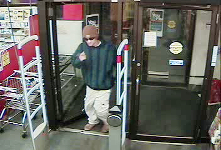 Security camera image showing the robbery suspect entering the CVS Pharmacy at 1096 Brighton Ave. in Portland.
