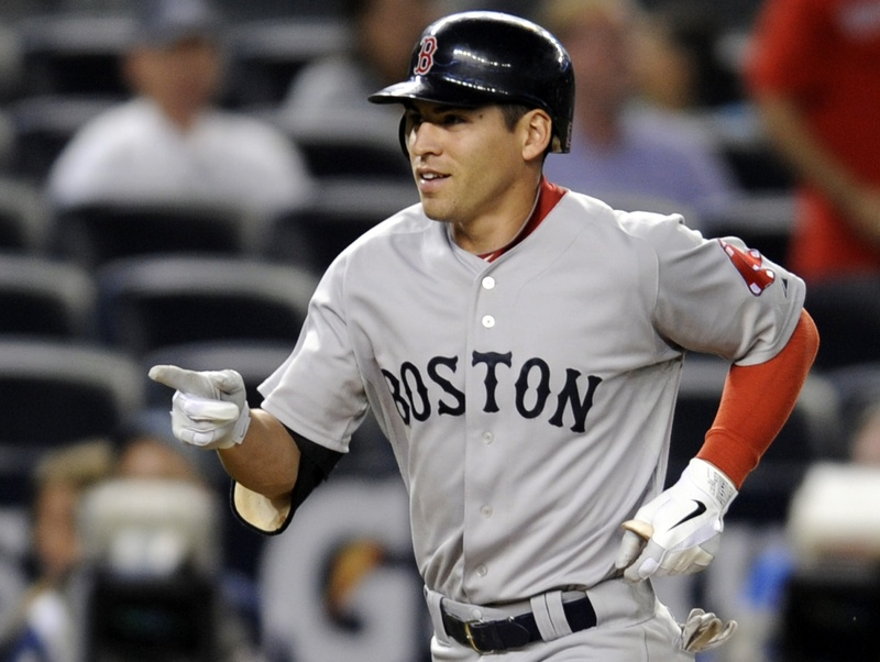 Jacoby Ellsbury rounds the bases after his three-run homer in the 14th inning Sunday night lifted the Red Sox to a 7-4 win over the Yankees.