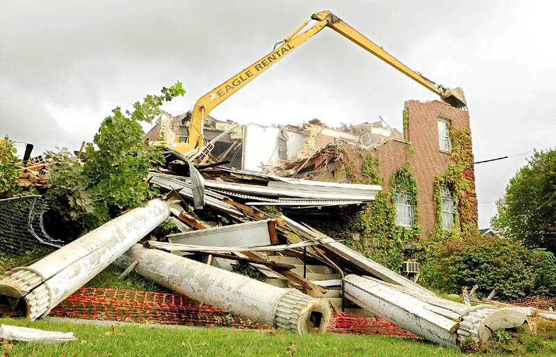 The columns sit on the ground as demolition continues today at the old Kennebec Valley YMCA building at the corner of State and Winthrop Streets in Augusta.