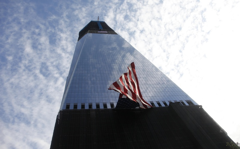 The U.S. flag hangs on Freedom Tower during the 10th Anniversary Commemoration Ceremony attended by President Barack Obama and former President George W. Bush, at Ground Zero today in New York.