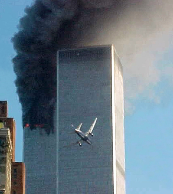 United Airlines Flight 175 approaches the south tower of the World Trade Center in New York shortly before collision as smoke billows from the north tower.