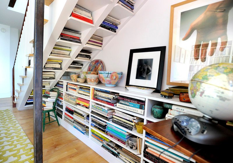 ... and clever under-the-stairs bookshelves.