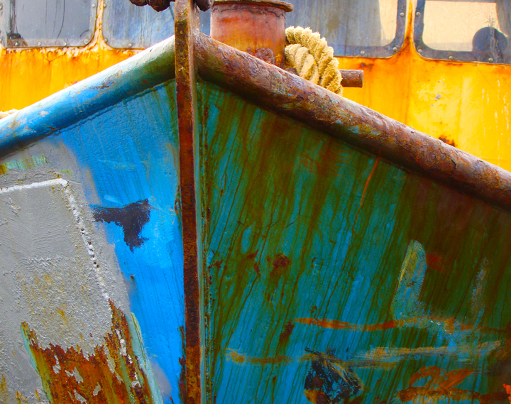 "Terry Hire's photograph ""Galilee Prelude"" reflects the hard life of a fishing vessel."