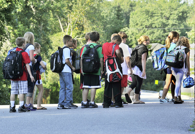 Students line up for the first day of school Wednesday at Dyer Elementary School in South Portland, while other schools open this week.