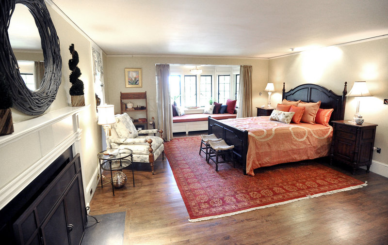 The expansive master suite has a fireplace and a window seat.