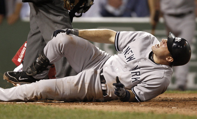 Mark Teixeira of the New York Yankees grabs his knee Thursday night after being plunked by an Alfredo Aceves pitch in the sixth inning. New York beat the Red Sox, 4-2.