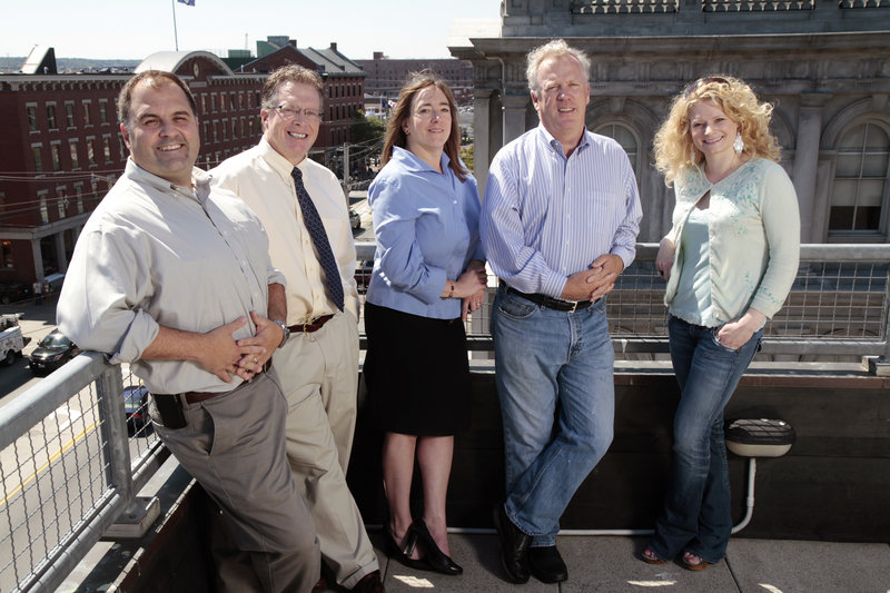 From left, MaineToday Digital executives Brent Taylor, manager of digital operations; Barry Jackman, director of advertising sales and marketing; Angie Muhs, executive editor; Steve Galligan, president; and Jaica Kinsman, executive producer, stand on the balcony of the company's offices at 7 Custom House St. in Portland on Friday.