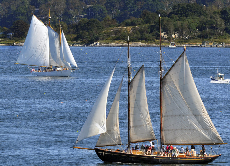 The Wendameen, top, and the Bagheera, both owned by the Portland Schooner Co., are seen under sail in Casco Bay recently. The boats have each run aground in the last two years, prompting discussion of safety and regulations by the Portland Harbor Commission.