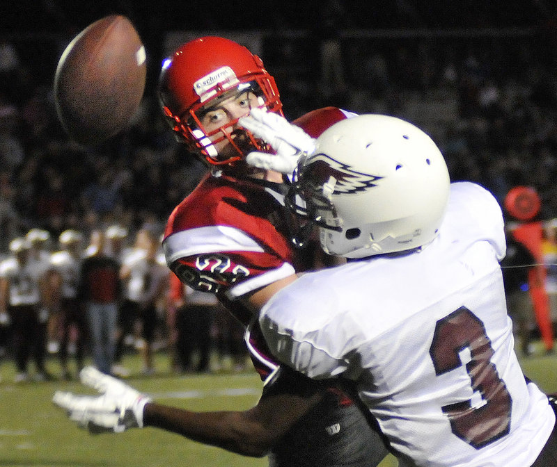 Tony Green-Taylor of Windham, right, breaks up a pass intended for Conor McCann of Scarborough in the second quarter of Scarborough s 21-6 victory Friday night.