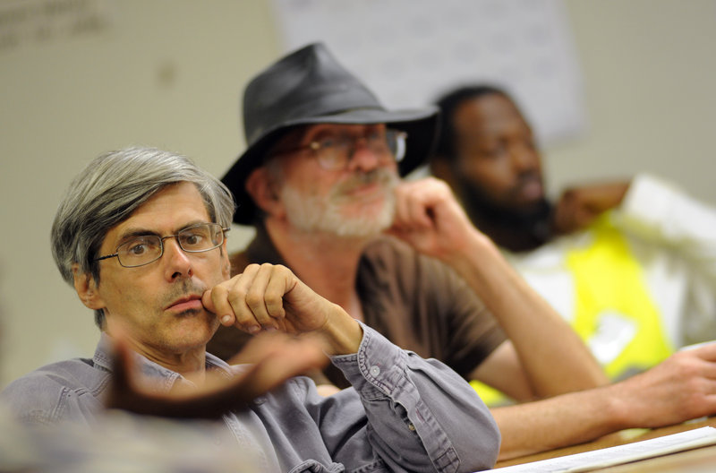 Unemployed men listen to a speaker Aug. 23 at the Philadelphia Unemployment Project. The jobless face increased hostility from conservative lawmakers, as more states cut the amount and duration of benefits, while making them harder to get and easier to lose.