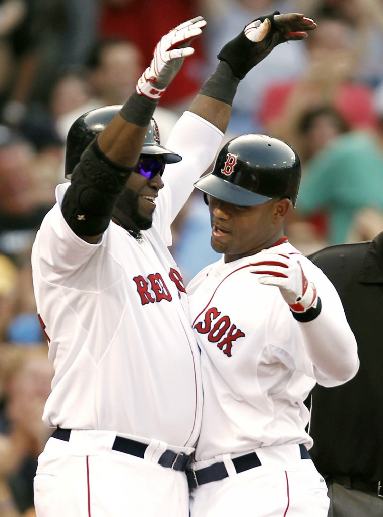David Ortiz, left, greets Carl Crawford after Crawford's grand slam that helped the Red Sox beat the Rangers.