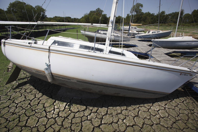 Sailboats sit on the parched bed of Benbrook Lake in Benbrook, Texas, during extreme drought conditions last month. Weather extremes across the nation in 2011 have included the hottest month ever recorded by any state: July in Oklahoma. The nation has had a record 10 weather catastrophes costing more than $1 billion each.