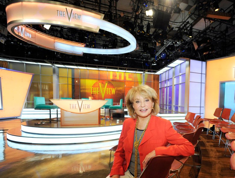 "Barbara Walters poses on the new set of the daytime talk show ""The View,"" which starts its 15th season Tuesday."