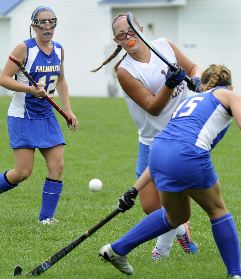 Working between Falmouth's Megan Fortier, left, and Hayley Winslow, right, Lake Region's Kayleigh Lepage gets off a shot Monday against the Yachtsmen.
