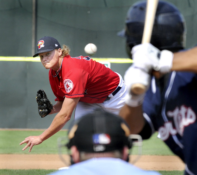 Portland's Will Latimer delivers a pitch against the New Hampshire Fisher Cats on Monday during the Sea Dogs season finale at Hadlock Field.
