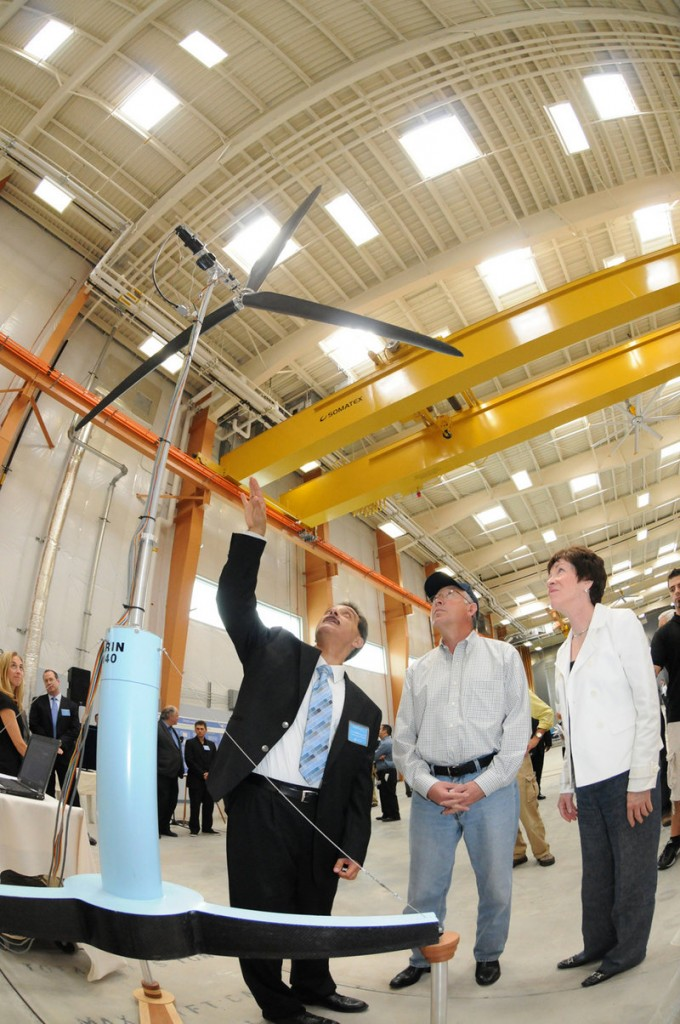 Habib Dagher, director of the University of Maine's Advanced Structures and Composites Center, left, shows U.S. Interior Secretary Ken Salazar and Sen. Susan Collins a scale model of a floating wind turbine in Orono. A $3 million federal grant will be used for a component lab that will build prototype blades, towers and hulls for floating windmills.