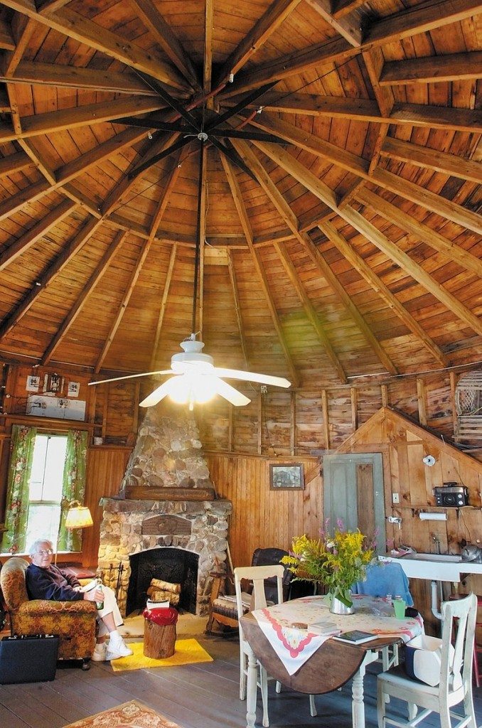 The Stone Cottage features a graceful, high ceiling above the third-floor bedroom of the round boathouse.