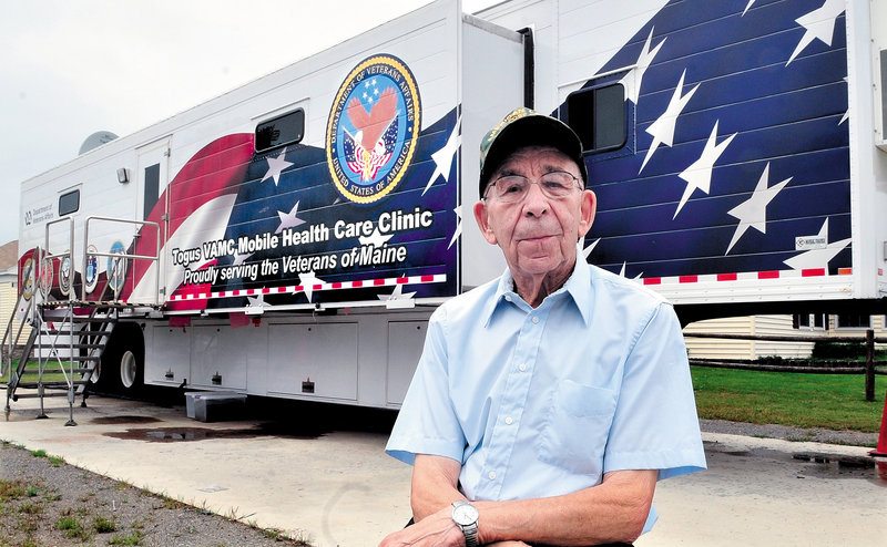 Veteran Joe Bourque, who is 92, stands outside the mobile health clinic near his home in Bingham on Sunday. Bourque and others will learn more this Wednesday at a public meeting about why the clinic will close.