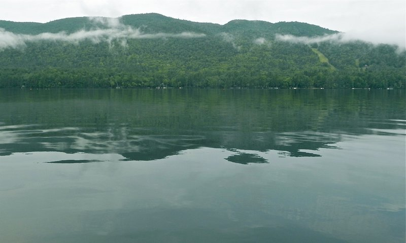 Pleasant Mountain, home of Shawnee Peak ski area, rises 1,500 feet above Moose Pond in Bridgton, an inviting place for a fall canoe or kayak excursion.