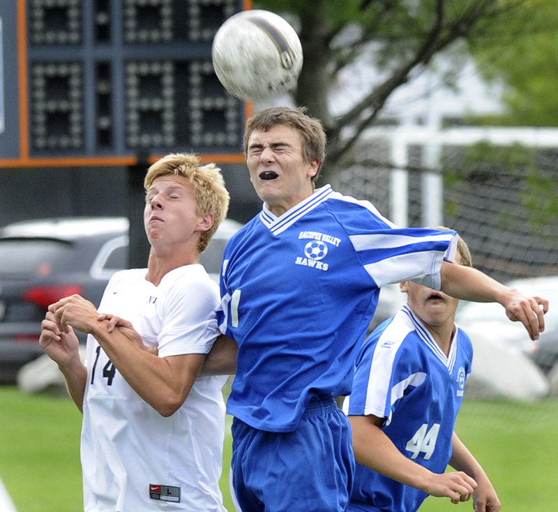 Trey Watson of Sacopee Valley gets his head on the ball Tuesday while holding off Jacob Scammon of North Yarmouth Academy. Watson scored a goal during Sacopee s 2-0 victory at Yarmouth.