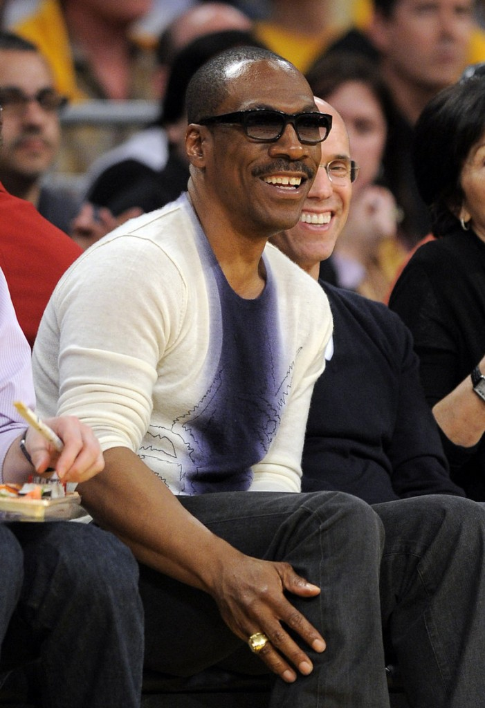 Actor Eddie Murphy, seen at a Lakers-Mavericks game during the NBA playoff series in May, made a surprising agreement to host the 84th Academy Awards ceremony this year.