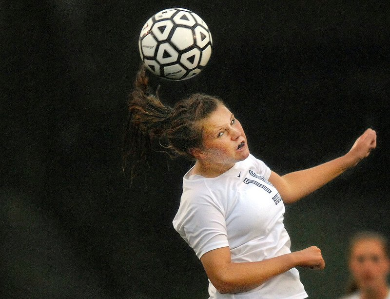 Ashley Frank of Portland keeps her concentration and heads the ball upfield Wednesday during the Western Class A schoolgirl soccer game against Noble at Fitzpatrick Stadium. Noble scored early and earned a 1-0 victory.
