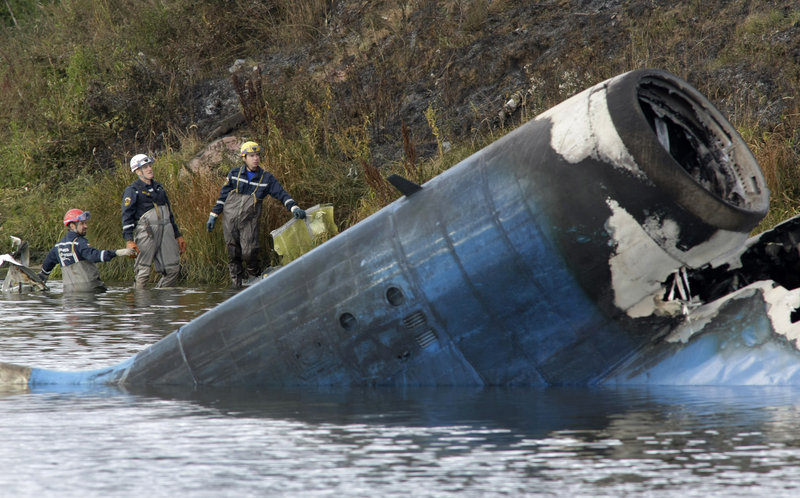 Rescuers on Wednesday survey the wreckage of a Russian Yak-42 jet that was carrying a Russian professional hockey team and crashed after takeoff some 150 miles from Moscow.