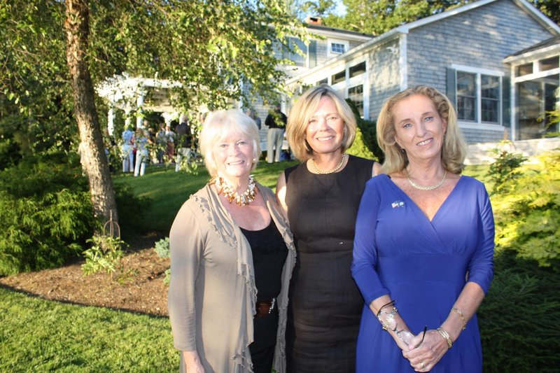 Carol Stratton, who helped select Maine art to be displayed in an embassy overseas, Cynthia Watson, who helped select the art and hosted the party celebrating the effort, and U.S. Ambassador to Gambia Pamela A. White.