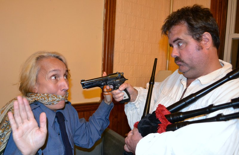 """Terri Plummer plays Officer Billie Dwyer and Mike Reardon is Todd, the Highland Hit Man, in """"Unnecessary Farce."""""""