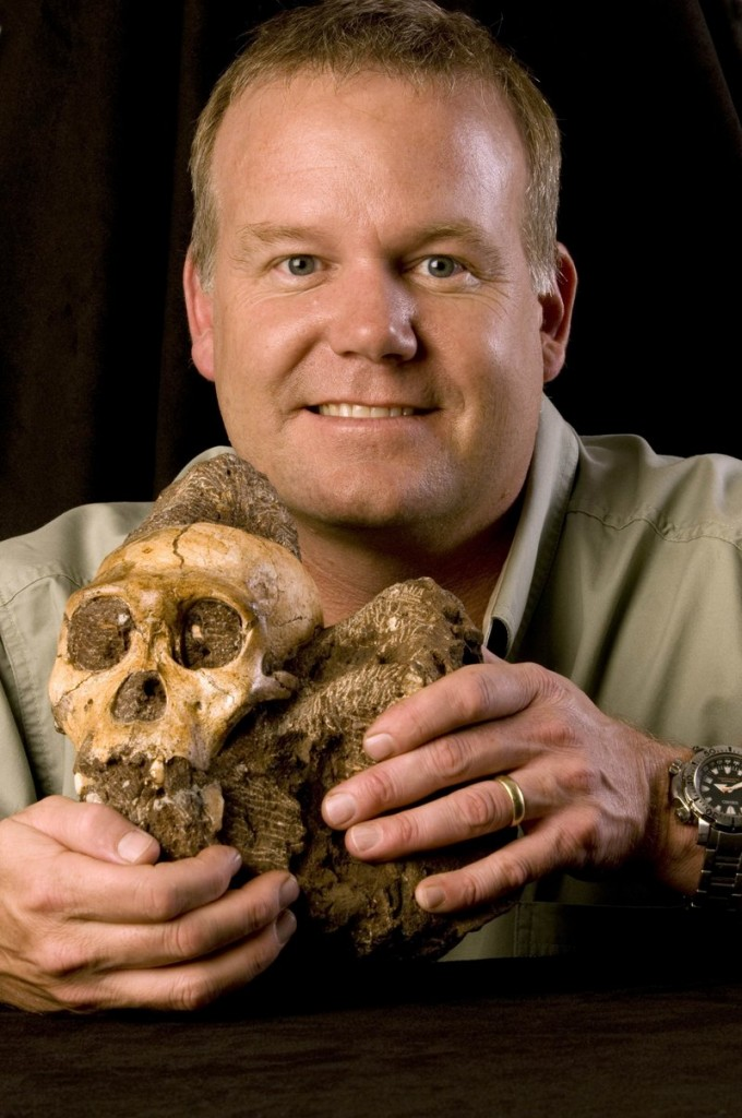 Lee R. Berger of the University of Witwatersrand in South Africa holds the 2 million-year-old cranium of Australopithecus sediba, found in South Africa.