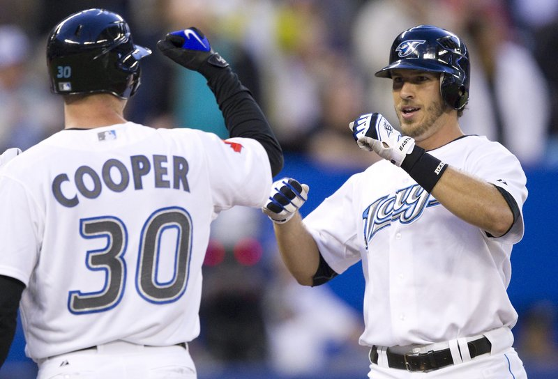 David Cooper welcomes J.P. Arencibia, who hit a three-run homer in the second inning Thursday night for the Toronto Blue Jays in the 7-4 victory against Boston.