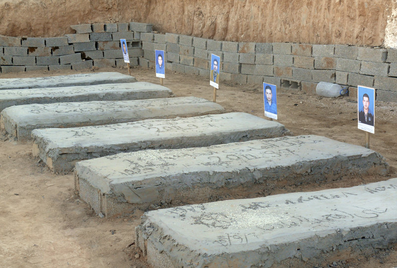 Tombs contain bodies that were reburied after being unearthed from a mass grave of 35 men in Galaa. Some 4,000 people remain missing across Libya.