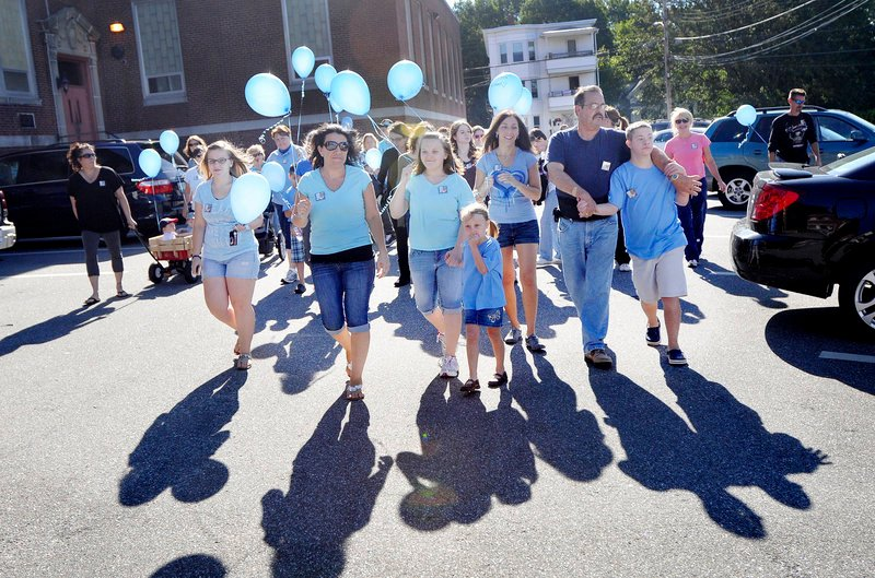 Participants set out on a walk to benefit the family of Liam Mahaney on Saturday in Biddeford.