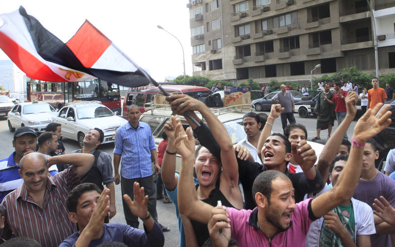 Egyptian activists wave their national flag near the Nile-side Israeli embassy in Cairo, Egypt, on Saturday.