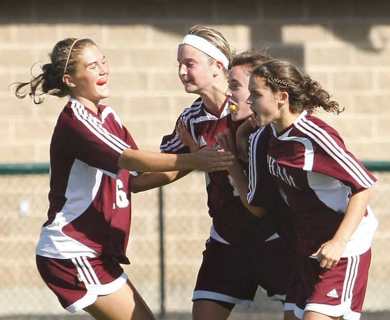 Libby Andreasen, left, celebrates with, left to right, Kiersten Turner, Kali St. Germain and Erin Smith after St. Germain scored the first-half goal that gave Gorham a 1-0 victory against Scarborough.