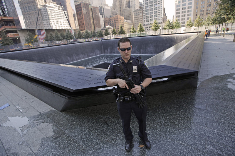A Port Authority police officer stands guard at the North Pool at the World Trade Center memorial site in New York on Friday. Security has been bolstered in New York and Washington for the Sept. 11 anniversary.