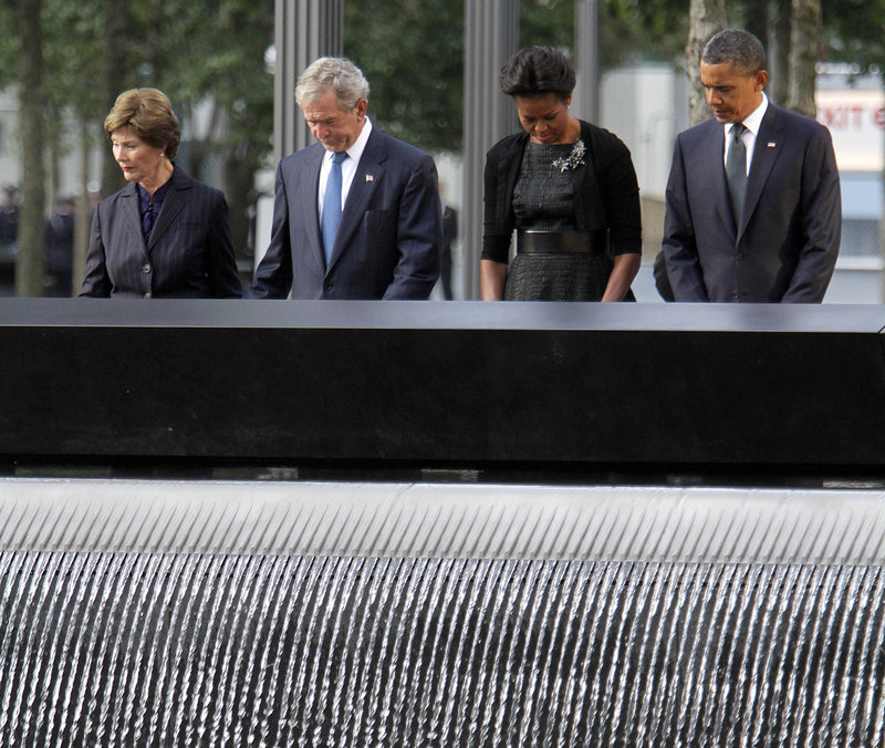A moment of silence is observed by, from left, former first lady Laura Bush, former President George W. Bush, first lady Michelle Obama and President Obama at the National September 11 Memorial in New York on Sunday.