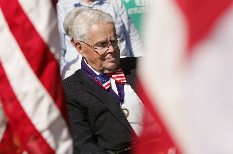 Roger P. Snelling, former Masonic grand master of Maine, listens to the ceremony in Freeport on Sunday.