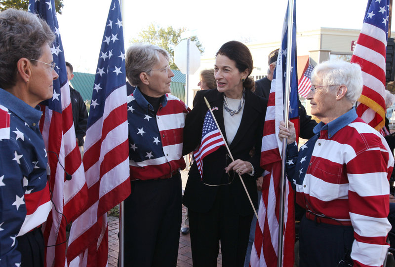 Freeport Flag Ladies Carmen Footer, left, Elaine Greene, center, and JoAnn Miller, right, speak with Sen. Olympia Snowe as they gather Sunday on Main Street in Freeport to mark the 10th anniversary of 9/11. Maine's entire congressional delegation attended the event.