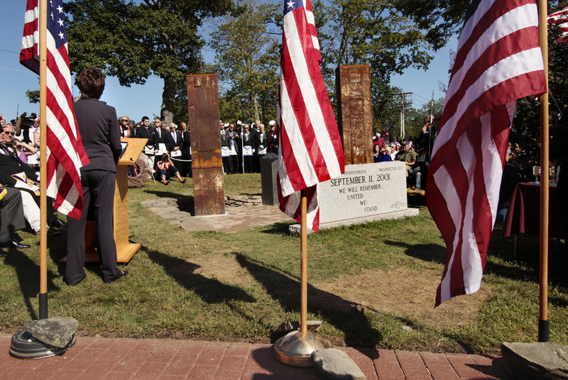 U.S. Sen. Susan Collins, R-Maine, left, speaks during the dedication of a monument, which is made of steel salvaged from the twin towers, in Freeport on Sunday.