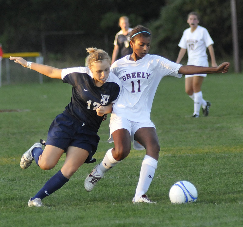 York's Hannah Daigneault fights for the ball with Greely's Samantha Kennedy on Monday in Cumberland. Greely won, 1-0.