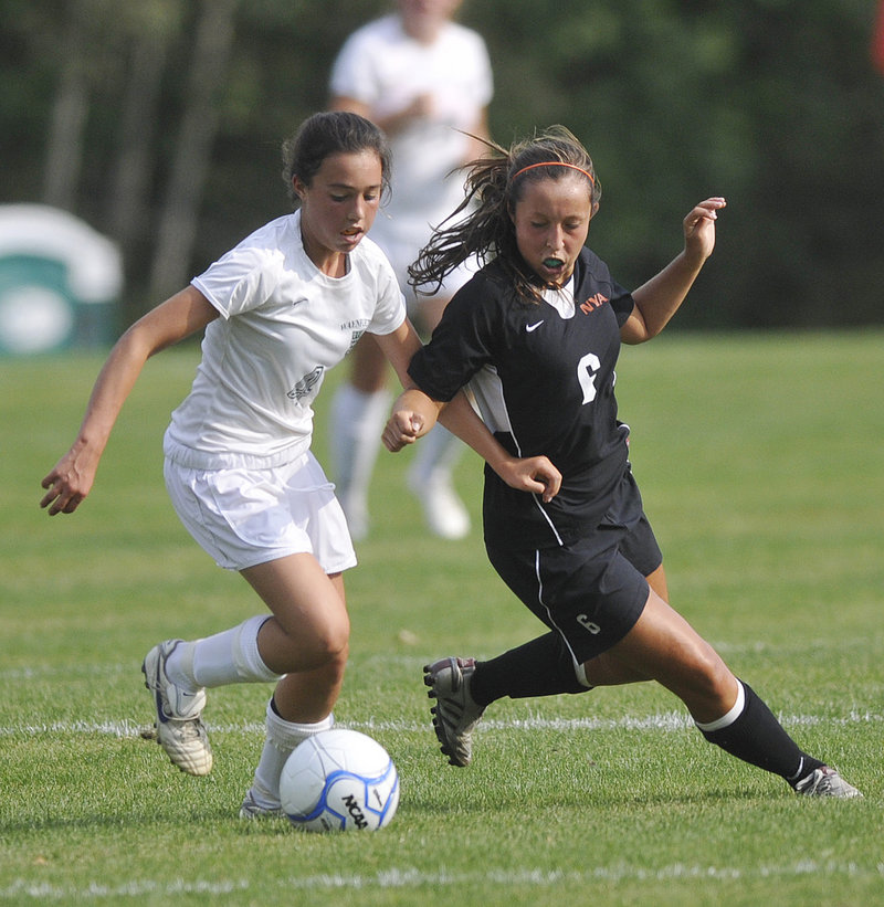 Sofia Canning of Waynflete, left, competes for the ball with Hannah Twombly of North Yarmouth Academy during their Western Maine Conference game Wednesday.
